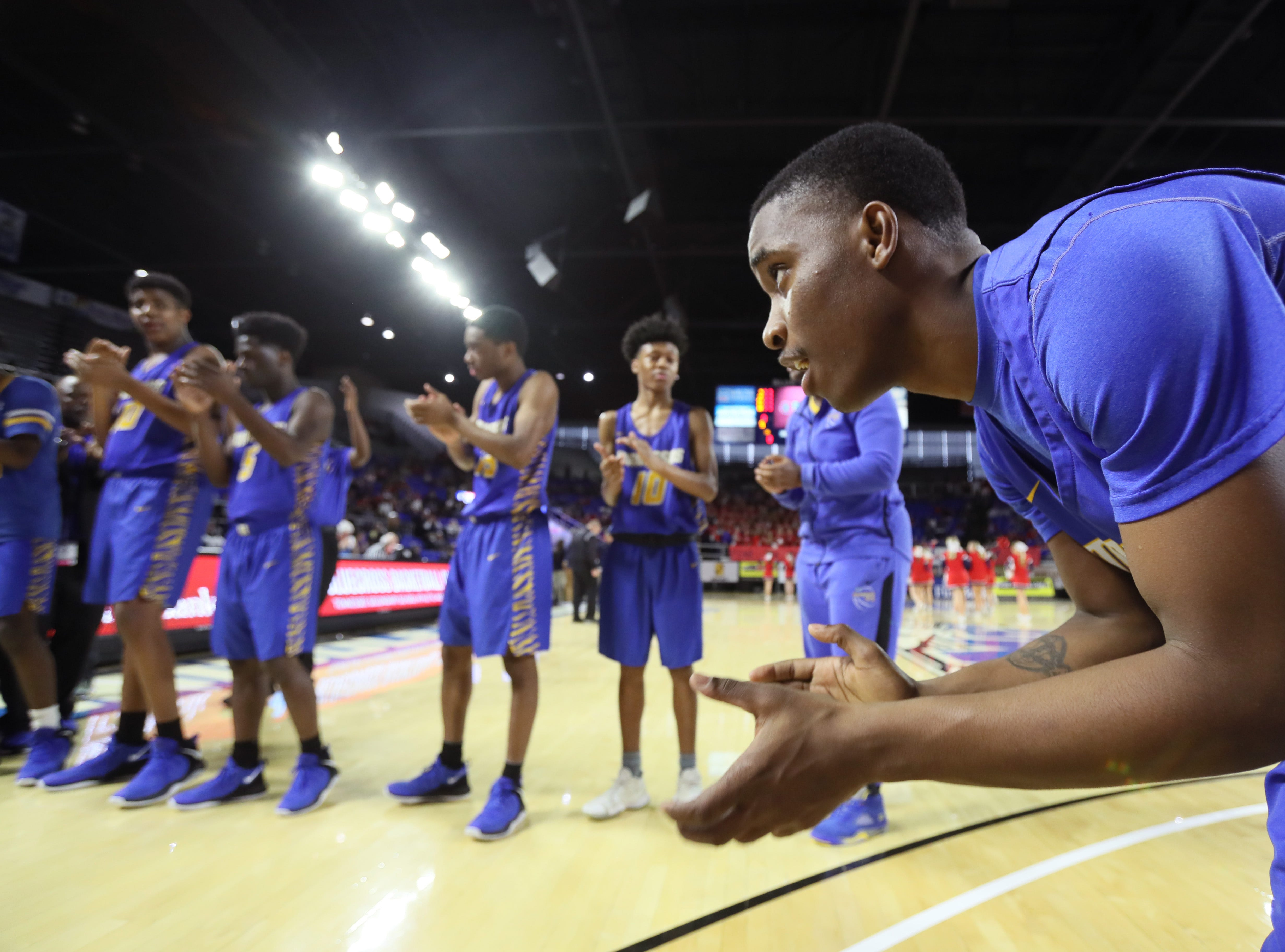Manassas' Devin Washington claps on his teammates as they are introduced before they take on Columbia Academy during the TSSAA Division I basketball state tournament at the Murphy Center in Murfreesboro on Thursday, March 14, 2019