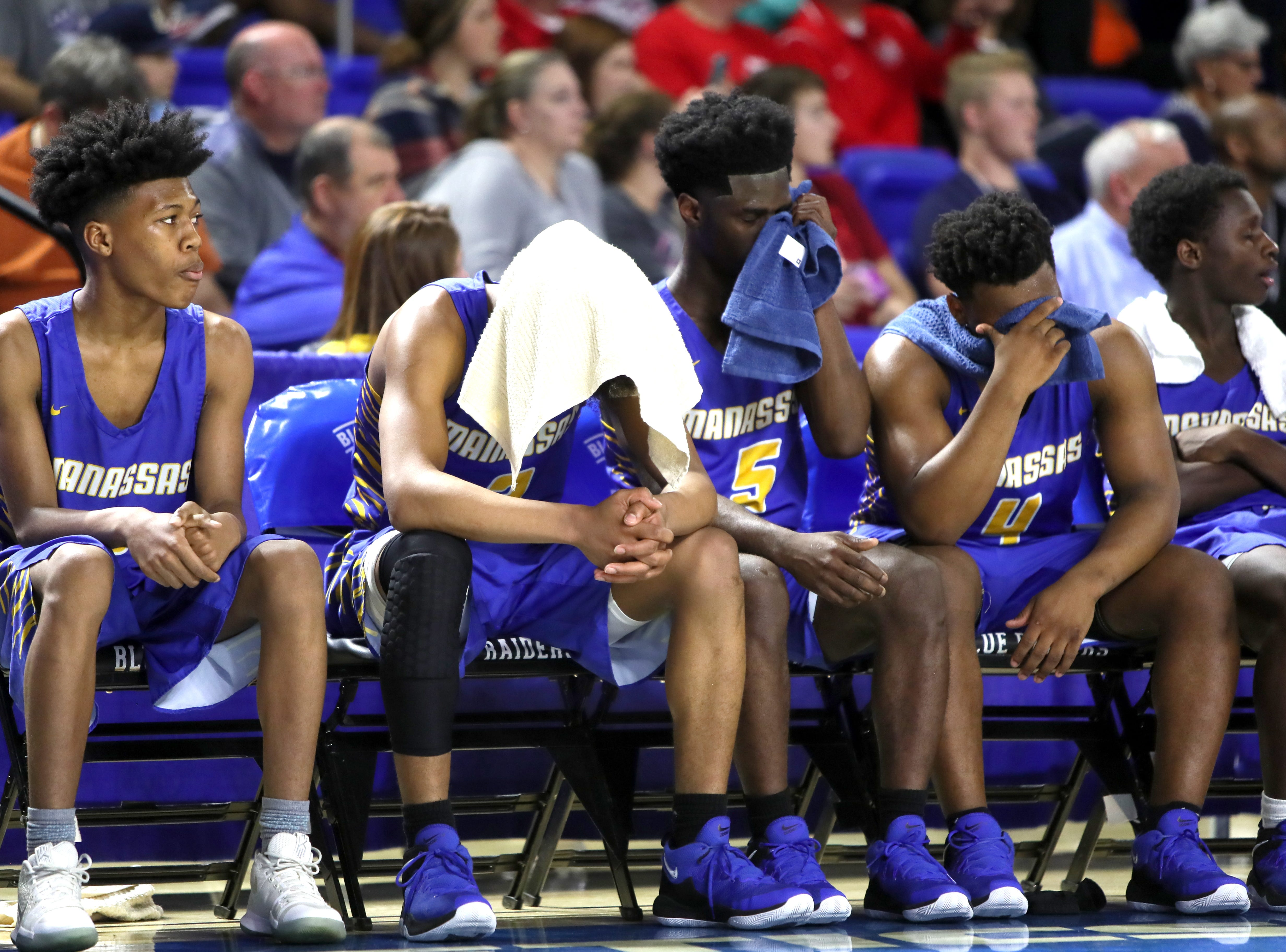 Manassas players cover their faces as the final seconds tick away on their 77-53 loss to Columbia Academy during the TSSAA Division I basketball state tournament at the Murphy Center in Murfreesboro on Thursday, March 14, 2019