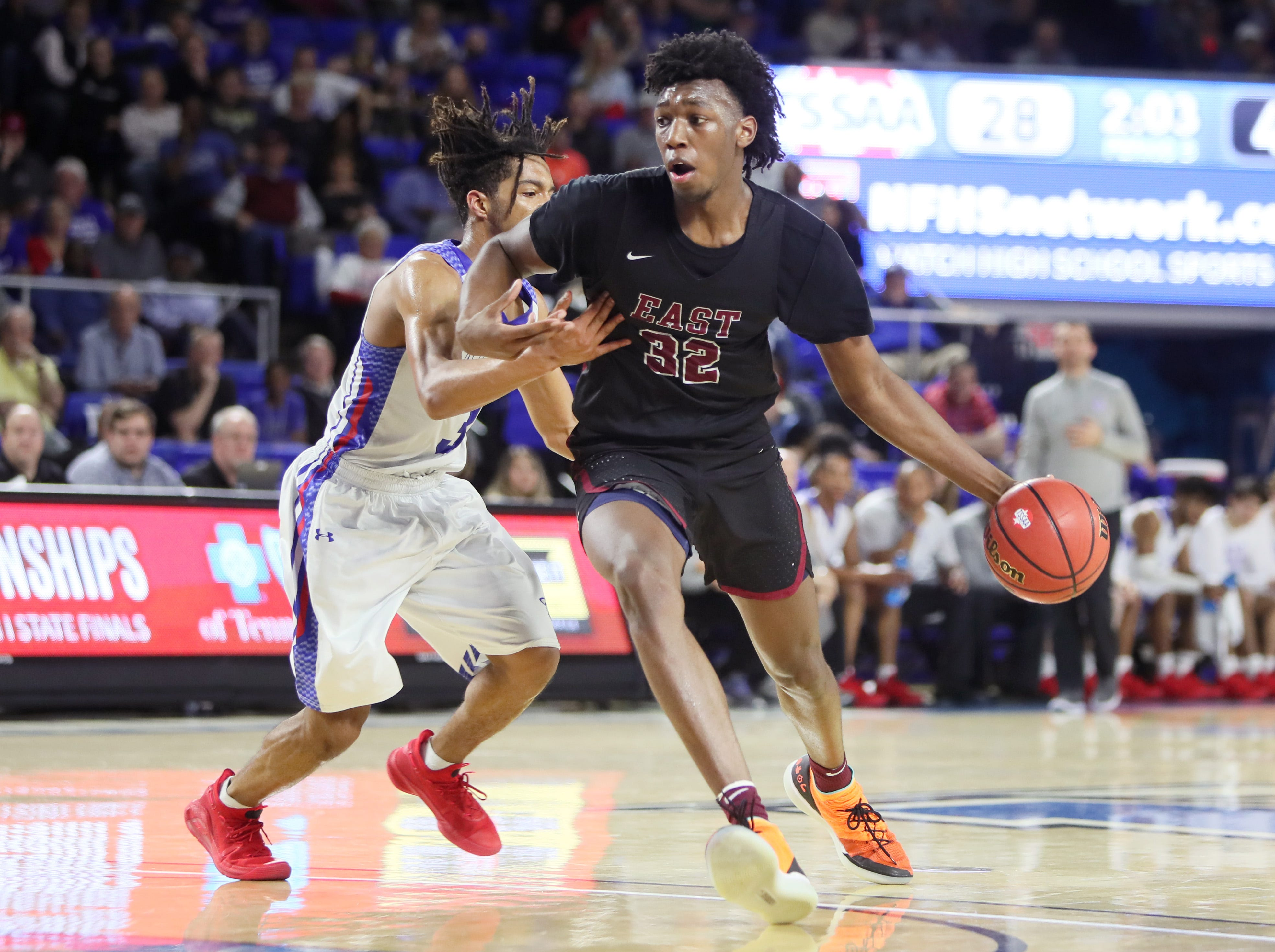 Memphis East's James Wiseman drives past Cleveland's Isaiah Johnson during the TSSAA Division I basketball state tournament at the Murphy Center in Murfreesboro, Tenn. on Thursday, March 14, 2019.