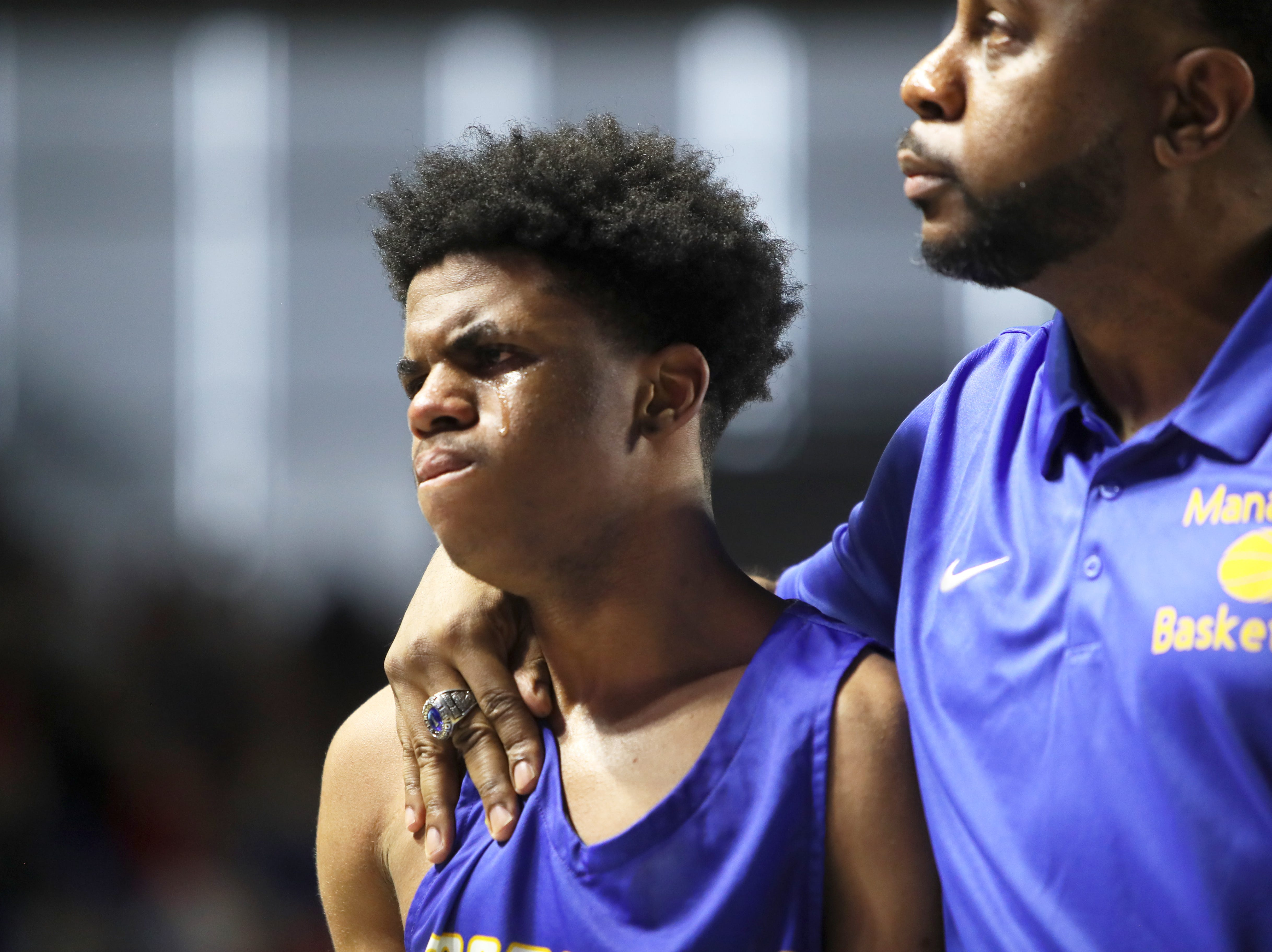 Manassas' Jalen Robinson shows his emotion after his team goes down 77-53 to Columbia Academy during the TSSAA Division I basketball state tournament at the Murphy Center in Murfreesboro on Thursday, March 14, 2019