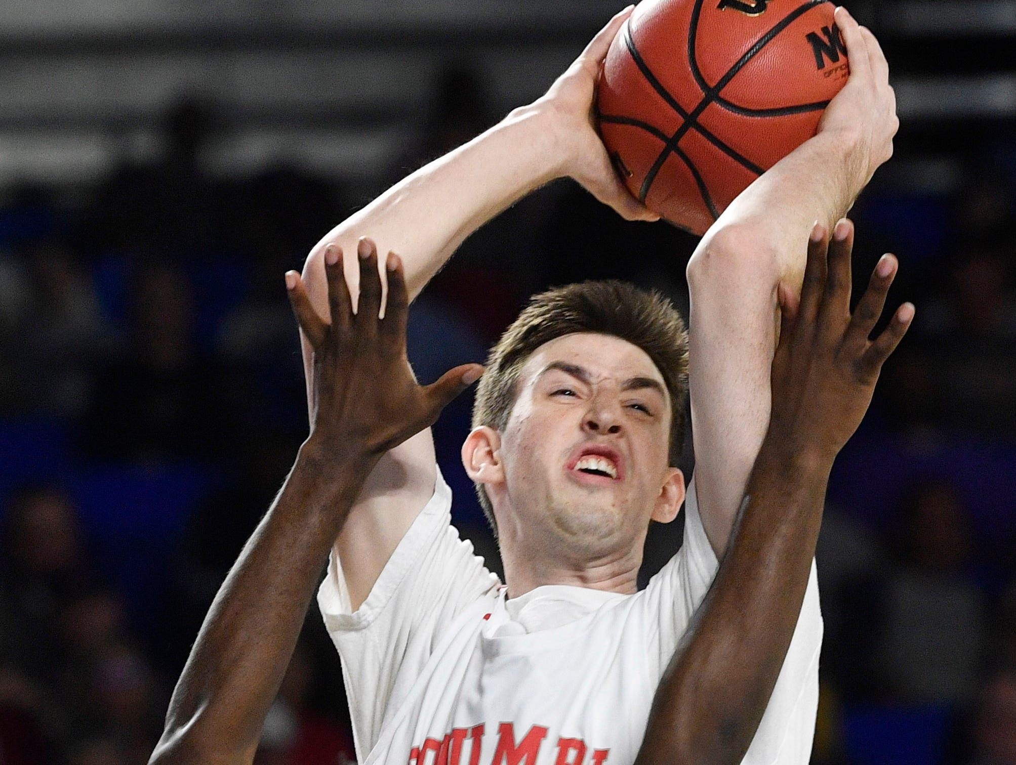 21 Eli Hyle tries to shoot over (11) Derrick Tucker as Manassas plays Columbia Academy in the TSSAA Class A quarterfinals  Thursday, March 14, 2019, in Murfreesboro, Tenn.