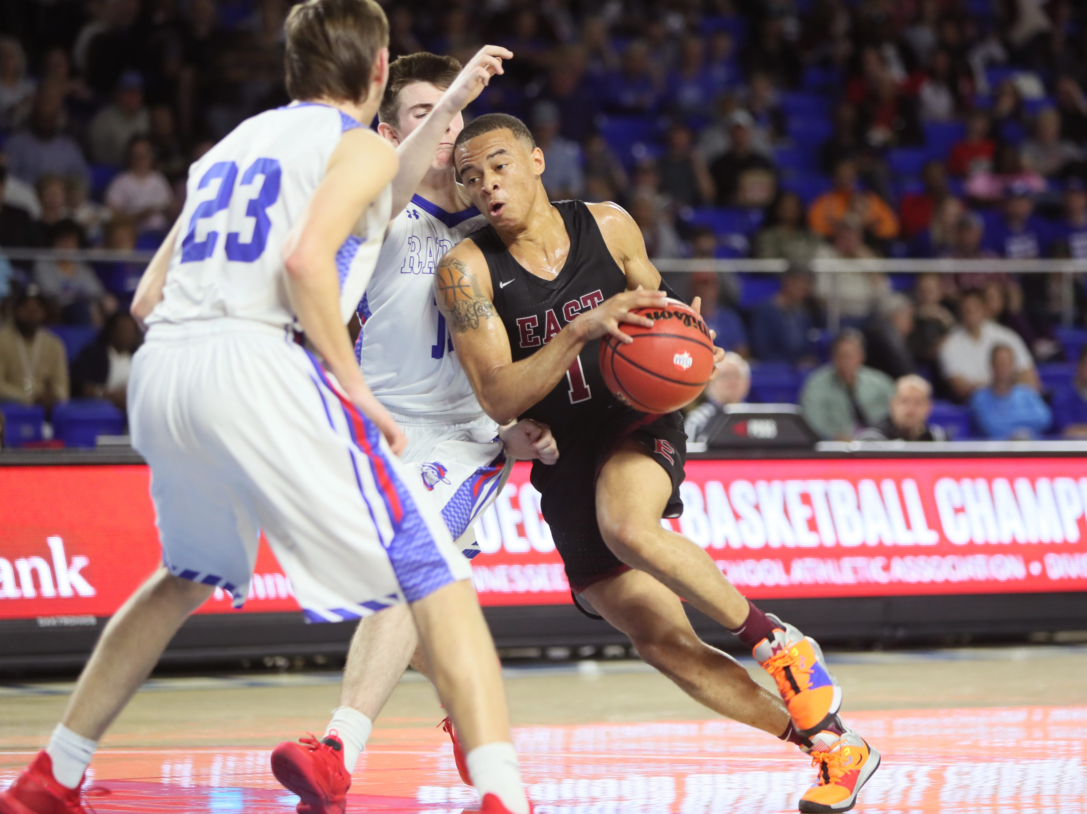Memphis East's Antonio Thomas drives past Cleveland's Grant Hurst during the TSSAA Division I basketball state tournament at the Murphy Center in Murfreesboro, Tenn. on Thursday, March 14, 2019.