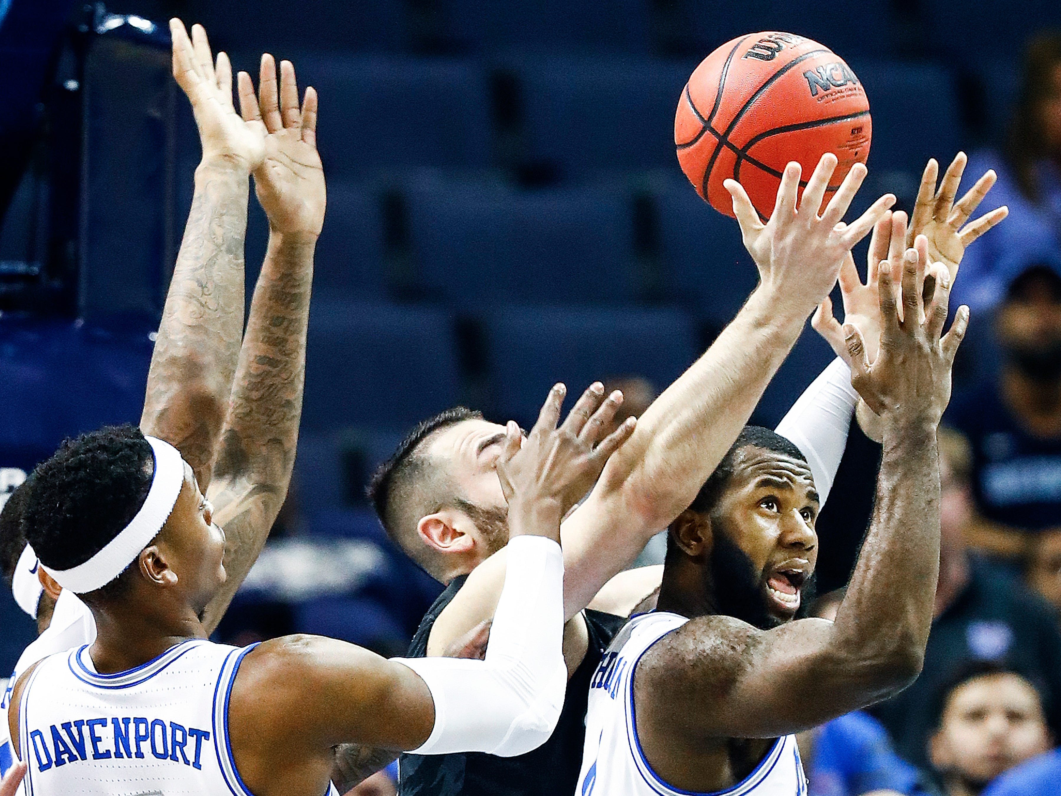 Memphis forward Raynere Thornton (right) tries to grab a rebound against Tulane during action of their first round AAC Tournament game at the  FedExForum, Thursday, March 14, 2019.