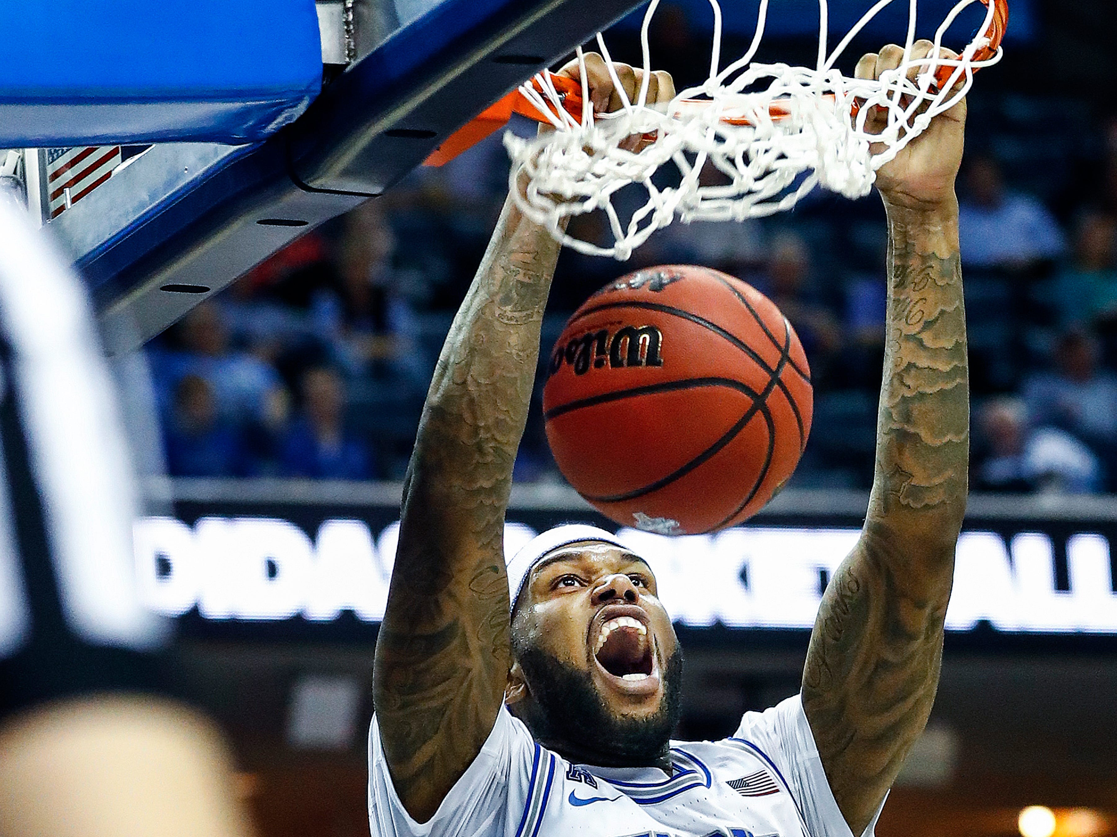 Memphis forward Mike Parks Jr. dunks over the Tulane defense during action of their first round AAC Tournament game at the  FedExForum, Thursday, March 14, 2019.