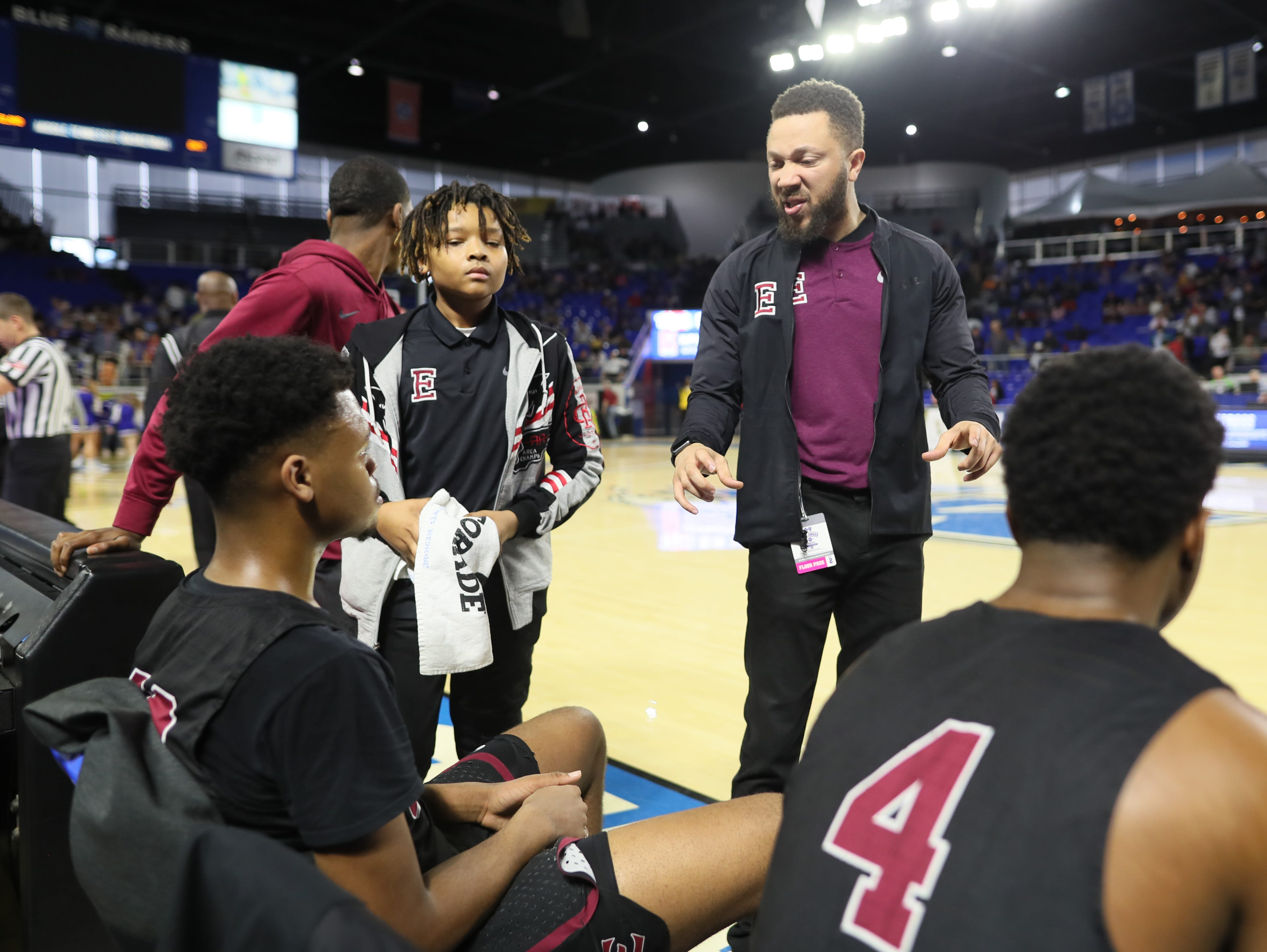 Memphis East Head Coach Jevonte Holmes talks to his team before they take on Cleveland during the TSSAA Division I basketball state tournament at the Murphy Center in Murfreesboro, Tenn. on Thursday, March 14, 2019.