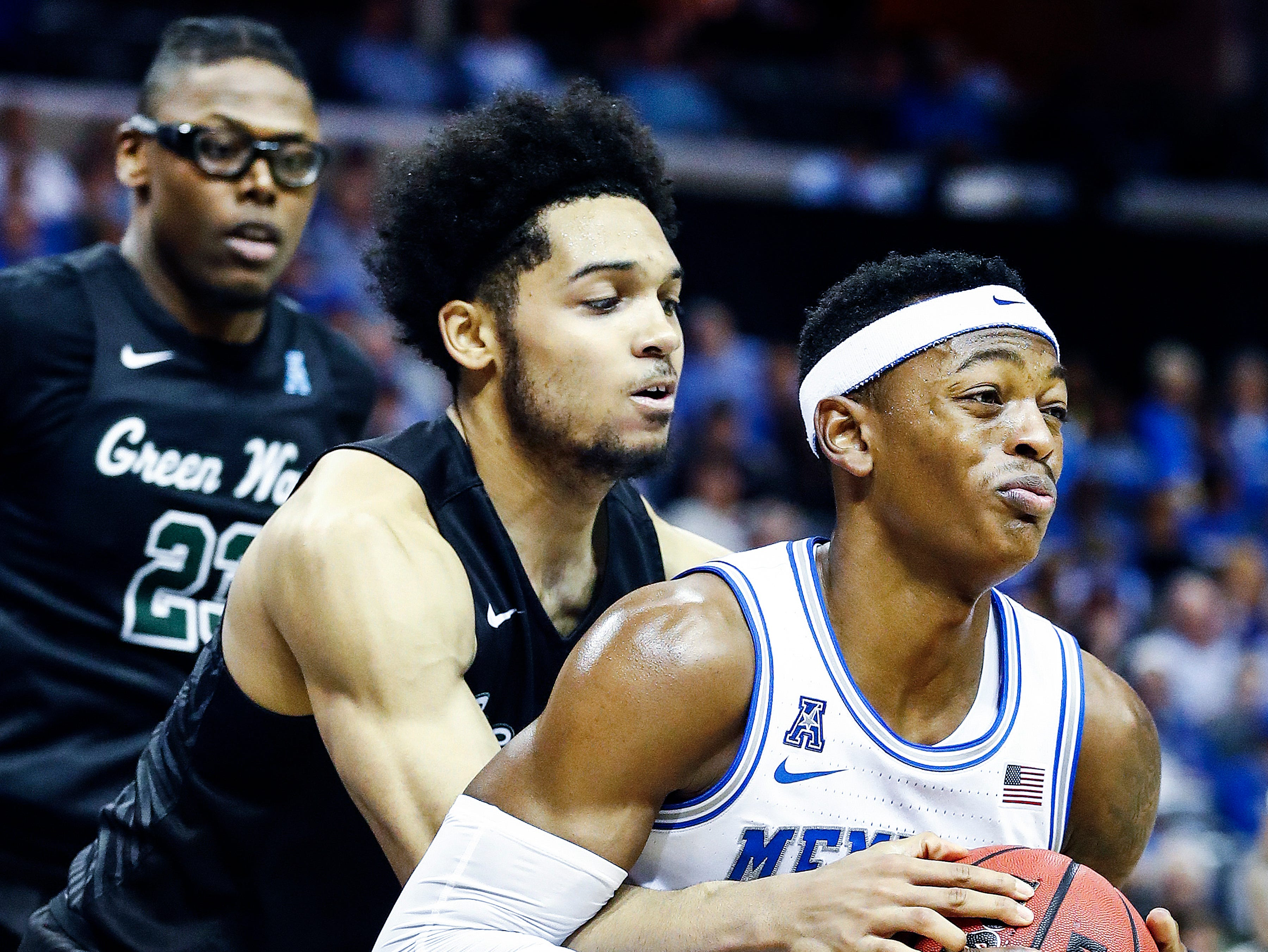Memphis forward Kyvon Davenport (right) is fouled by Tulane defender Caleb Daniels (left) during action of their first round AAC Tournament game at the  FedExForum, Thursday, March 14, 2019.
