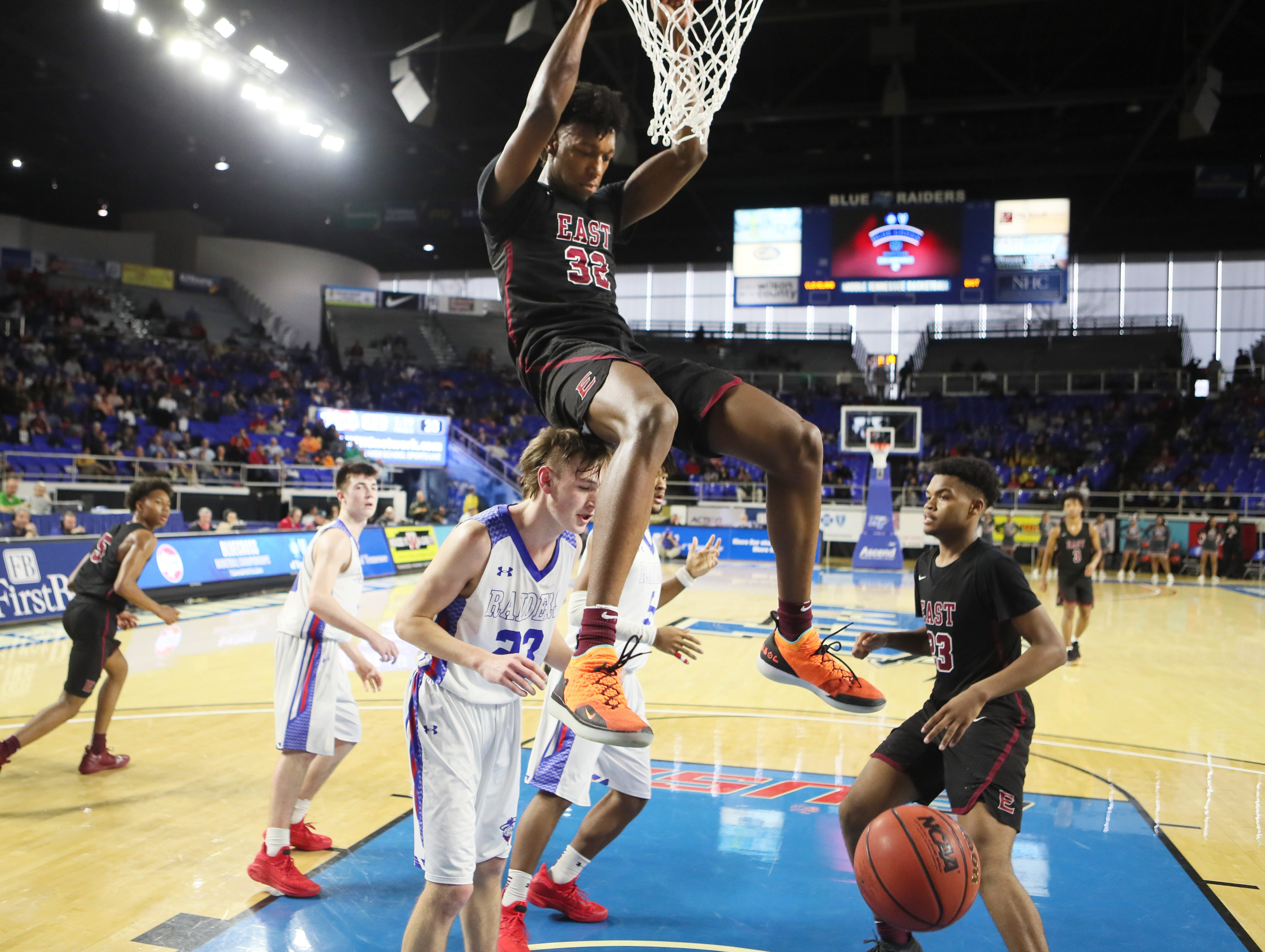 Memphis East's James Wiseman dunks the ball over Cleveland's Klay McGowan during the TSSAA Division I basketball state tournament at the Murphy Center in Murfreesboro, Tenn. on Thursday, March 14, 2019.