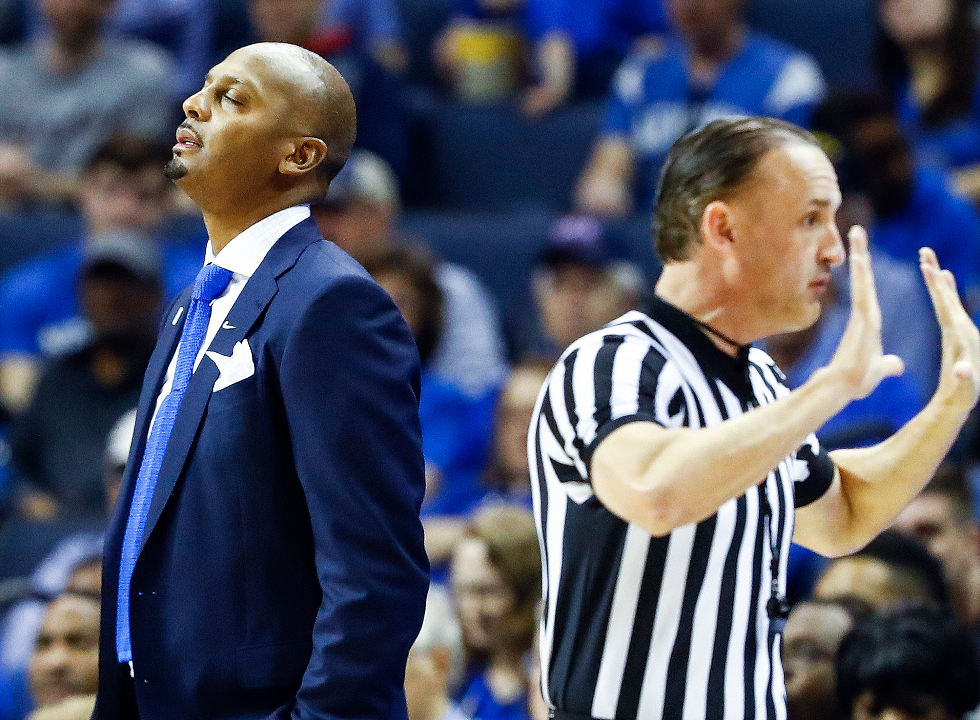Memphis head coach Penny Hardaway (left0 reacts to an officials foul call against the Tigers during action against Tulane in their first round AAC Tournament game at the  FedExForum, Thursday, March 14, 2019.