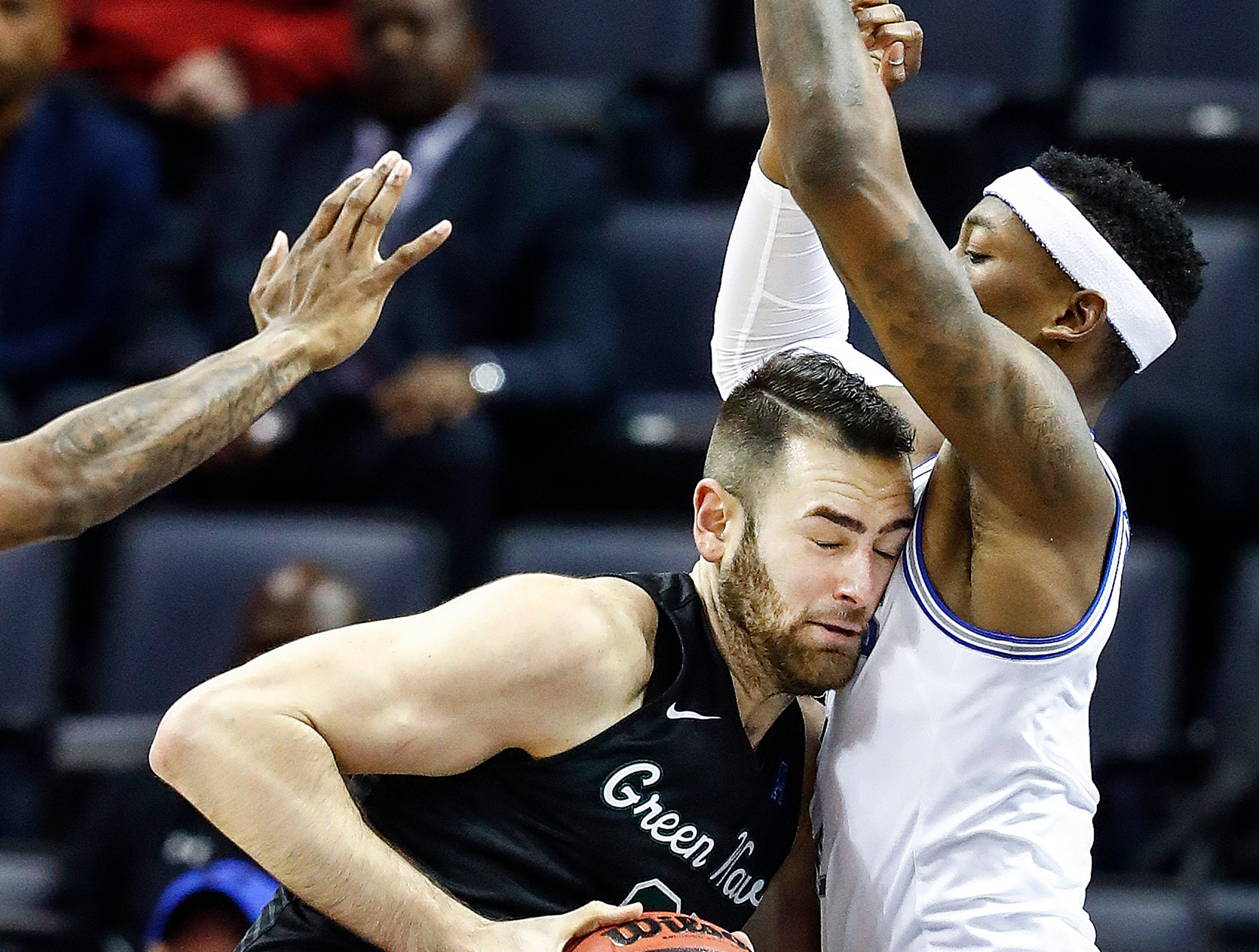 Memphis defender Kyvon Davenport (right) applies pressure to Tulane forward Samir Sehic (left) during action of their first round AAC Tournament game at the  FedExForum, Thursday, March 14, 2019.