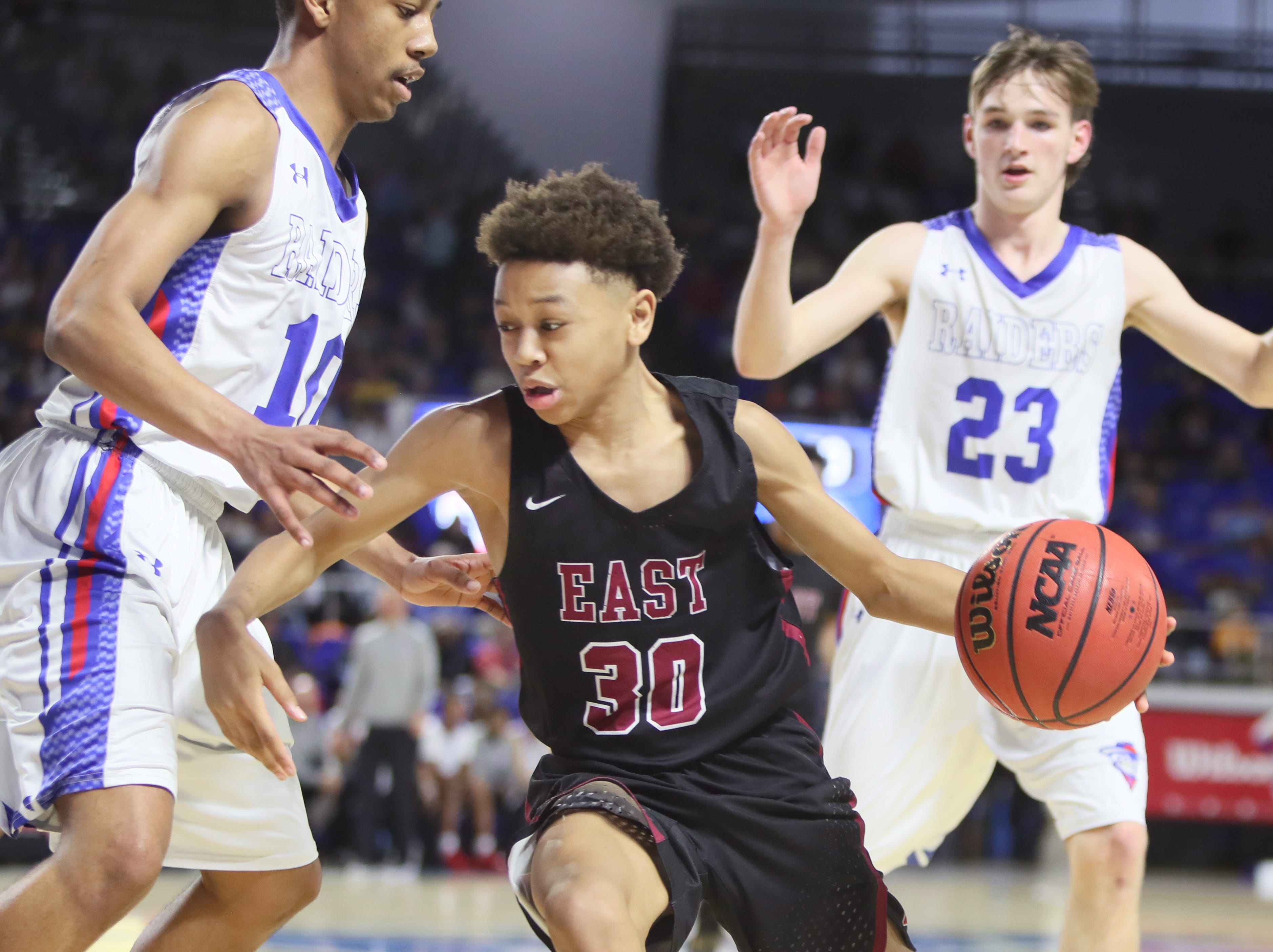 Memphis East's Terrence Jacobs tries to drive past Cleveland's Jacobi Wood during the TSSAA Division I basketball state tournament at the Murphy Center in Murfreesboro, Tenn. on Thursday, March 14, 2019.