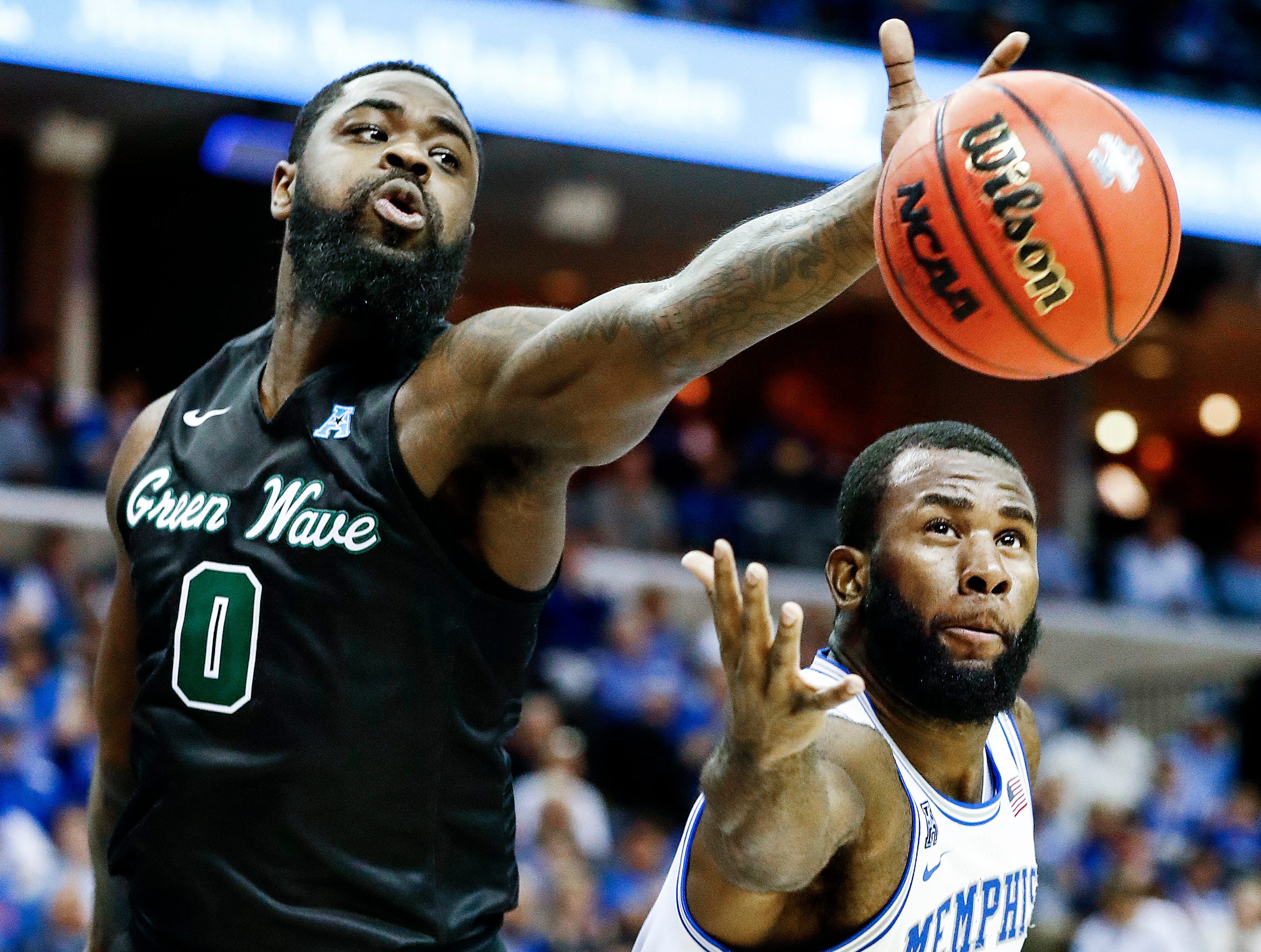 Memphis forward Raynere Thornton (right) battles Tulane defender Jordan Cornish (left) for a rebound during action of their first round AAC Tournament game at the  FedExForum, Thursday, March 14, 2019.