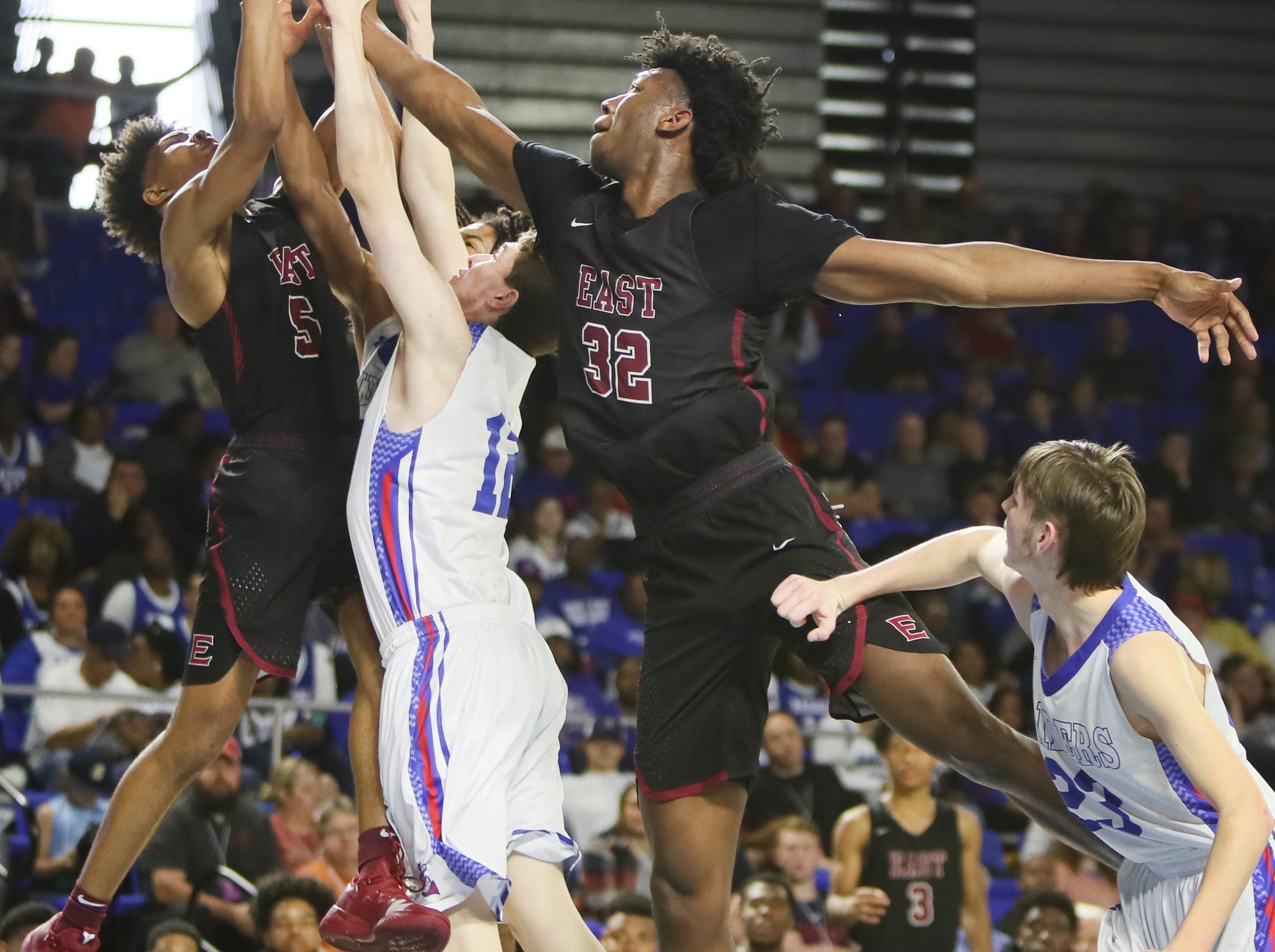 Memphis East's Tadarius Jacobs, left, and James Wiseman battle Cleveland's Logan Colbaugh for a rebound during the TSSAA Division I basketball state tournament at the Murphy Center in Murfreesboro, Tenn. on Thursday, March 14, 2019.