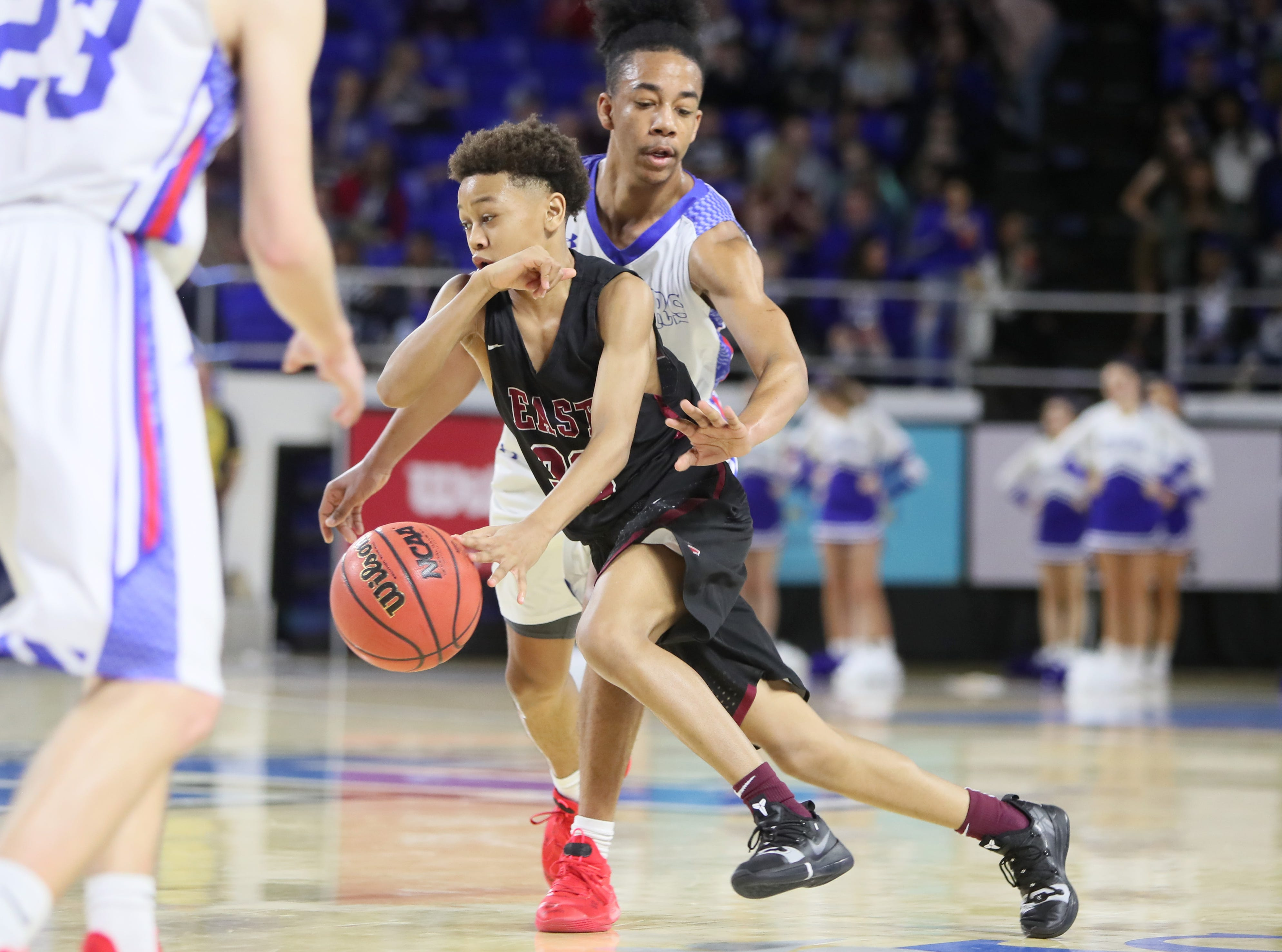 Memphis East's Terrence Jacobs drives past Cleveland's Jacobi Wood during the TSSAA Division I basketball state tournament at the Murphy Center in Murfreesboro, Tenn. on Thursday, March 14, 2019.