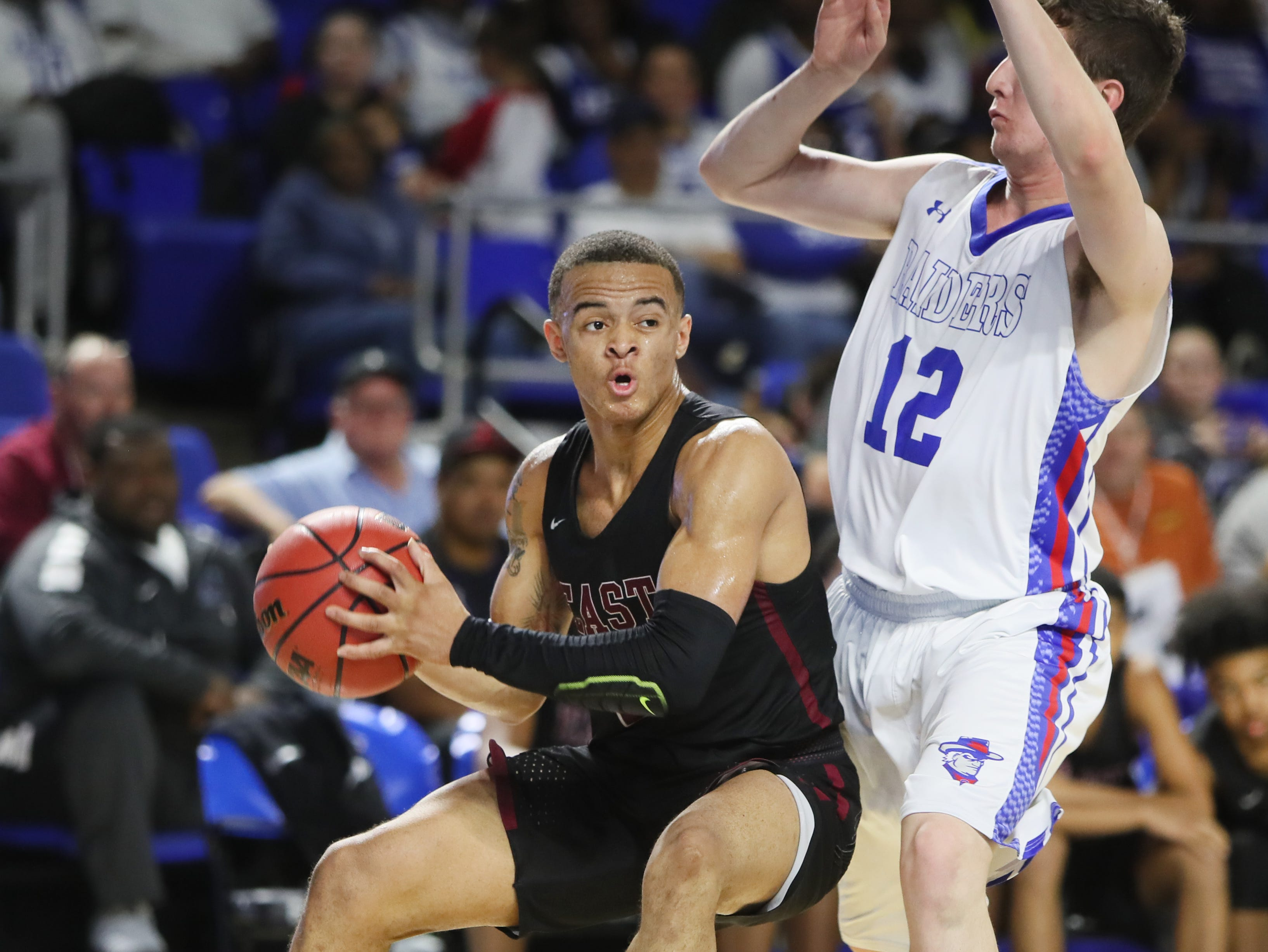 Memphis East's Antonio Thomas looks to pass the ball past Cleveland's Logan Colbaugh during the TSSAA Division I basketball state tournament at the Murphy Center in Murfreesboro, Tenn. on Thursday, March 14, 2019.