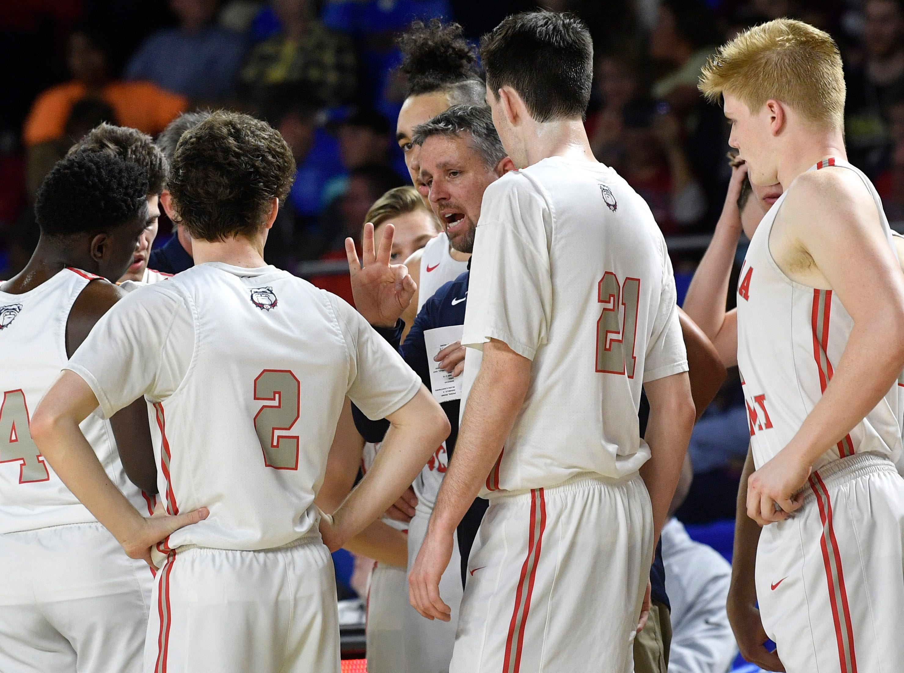 Coach Marty DeJarnette talks with his players as Manassas plays Columbia Academy in the TSSAA Class A quarterfinals  Thursday, March 14, 2019, in Murfreesboro, Tenn.