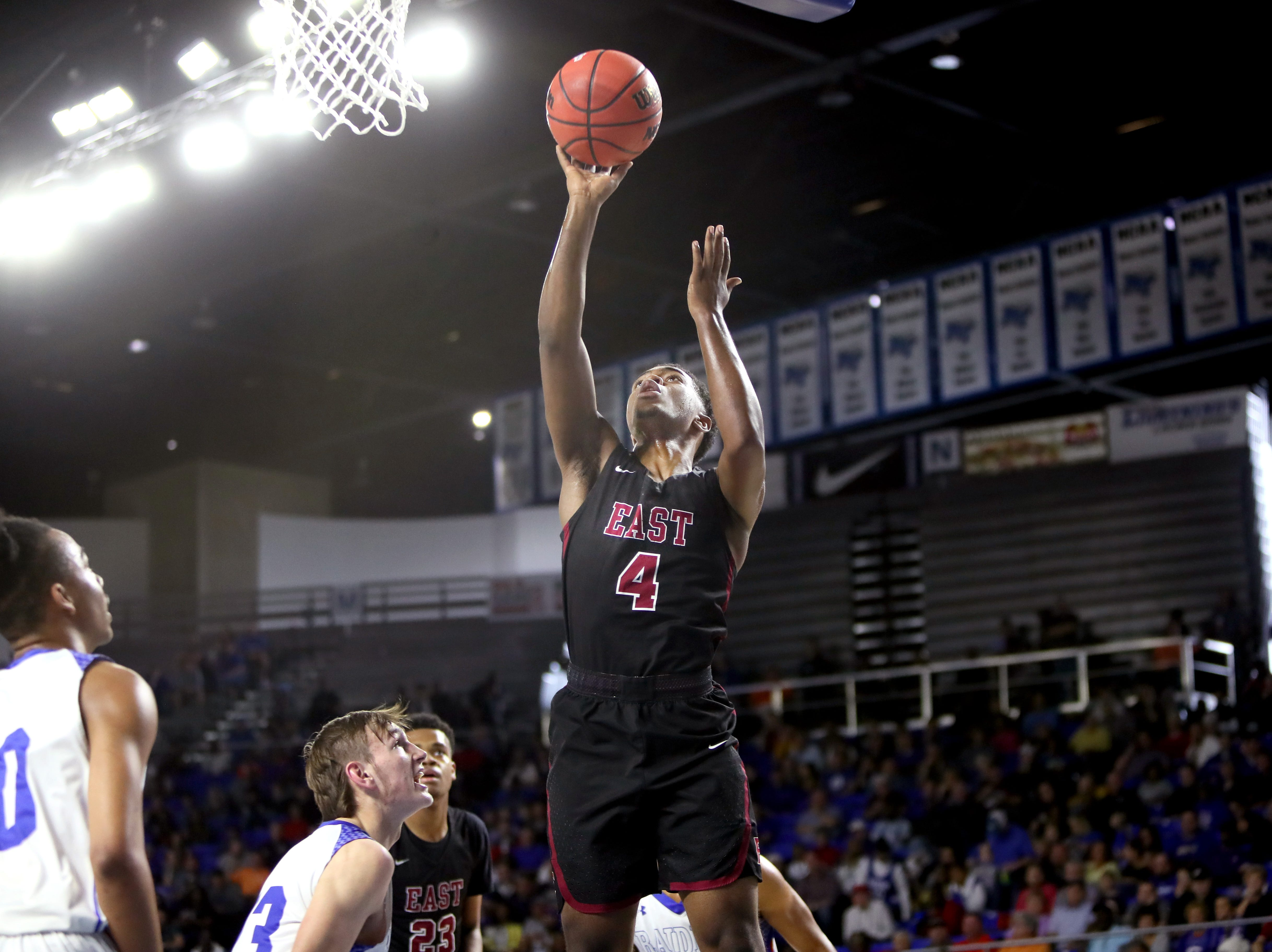 Memphis East's Isaiah Cathey shoots the ball against Cleveland during the TSSAA Division I basketball state tournament at the Murphy Center in Murfreesboro, Tenn. on Thursday, March 14, 2019.