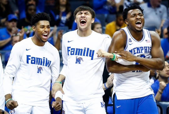 Memphis teammates, from left, Ryan Boyce, David Wingett and Victor Enoh celebrate during a 83-68 victory over Tulane on Thursday.