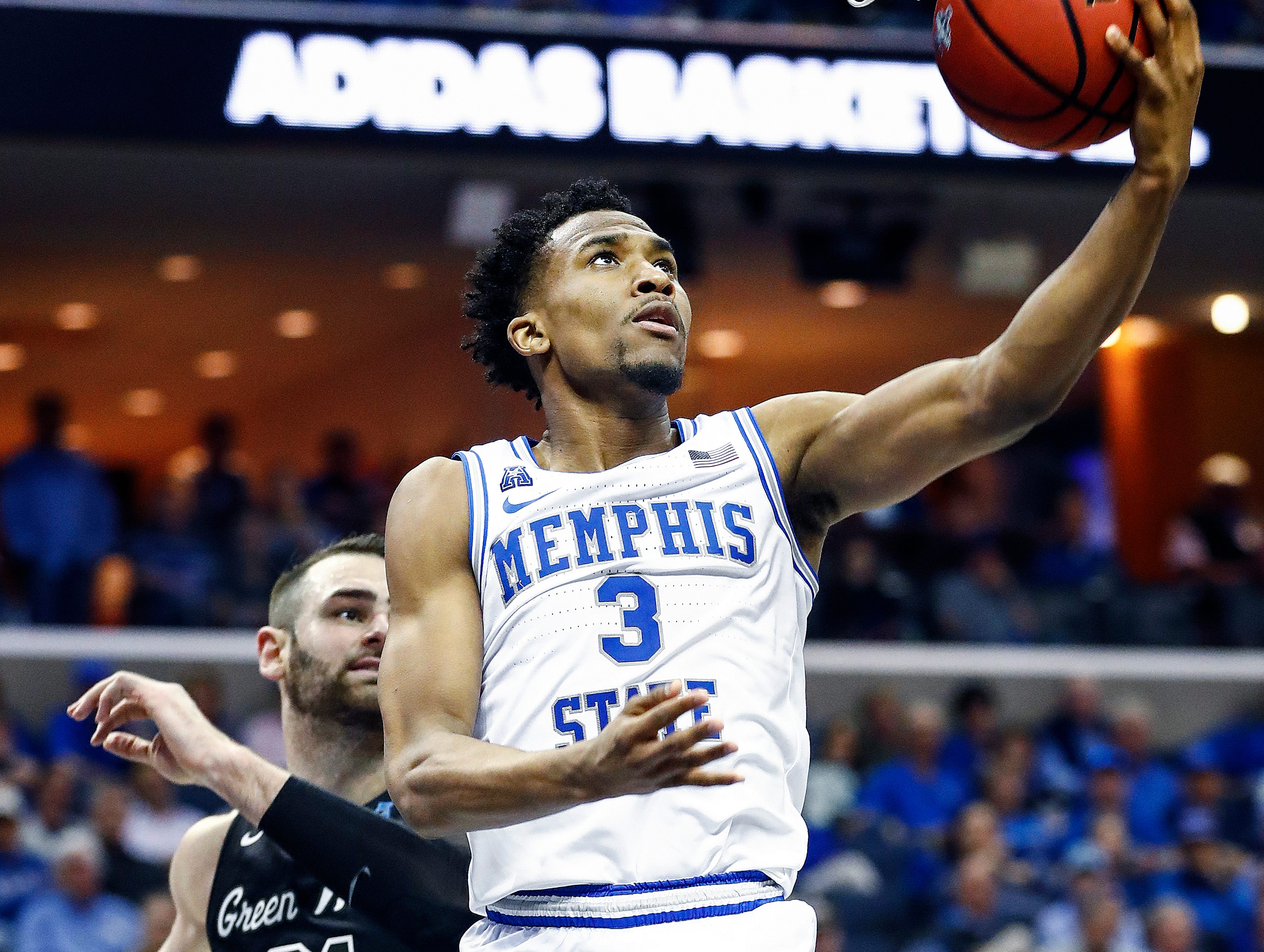 Memphis guard Jeremiah Martin (left) drives to the baked against the Tulane defense during action of their first round AAC Tournament game at the  FedExForum, Thursday, March 14, 2019.
