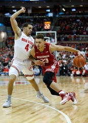 Wisconsin's Kobe King (right) struggled a bit against Ohio State on Sunday, finishing with two points, two rebounds and two assists.