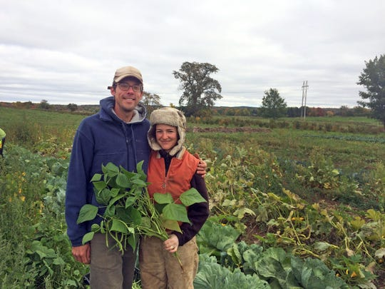 Kelly Kiefer (right), with husband Jeff Schreiber, cater to 125 CSA customer familes with vegetables. Planting an orchard is next up.