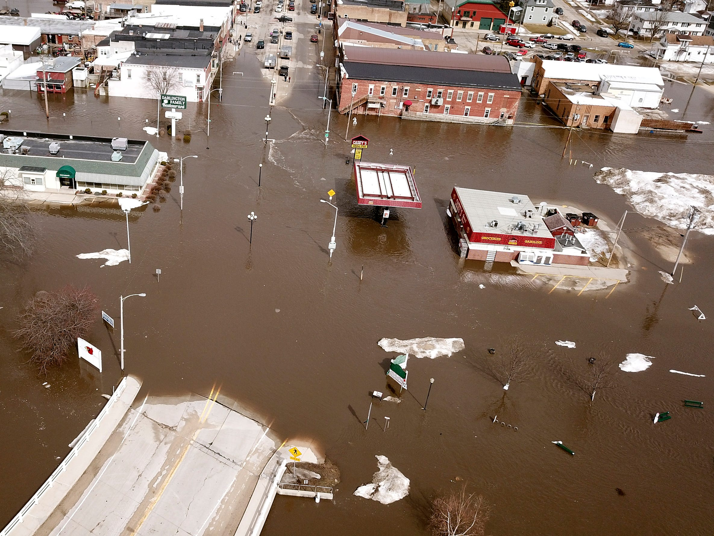 The swollen Pecatonica River spills into downtown Darlington, Wis., on Thursday March 14, 2019.  The National Weather Service has issued a flood warning or flood watch for about two-thirds of the state.