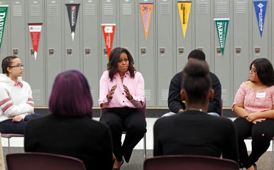 "Former first lady Michelle Obama, center, joins area high school students in a round table discussion about their college aspirations Thursday at Milwaukee Collegiate Academy, 4030 N. 29th St. Obama, in town to promote her best-selling memoir, ""Becoming,"" made a surprise visit to the school to take part in the discussion."
