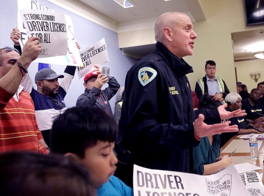 Madison Police Chief Mike Koval speaks in support of a proposed state budget inclusion that would provide immigrants without Social Security numbers an opportunity to obtain a driver's license during a rally and press conference at the Wisconsin State Capitol in Madison, Wis. Thursday, March 14, 2019.