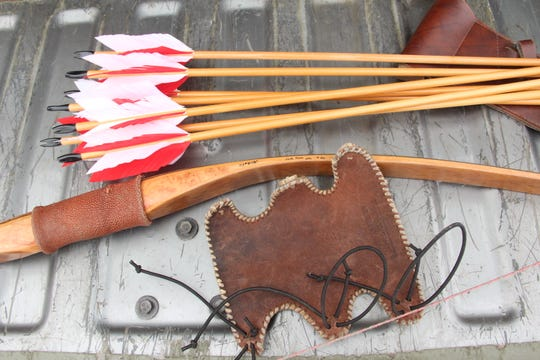 Traditional archery equipment, including a recurve bow and wooden shafted arrows with flu-flu fletchings, was used on the pheasant hunt.