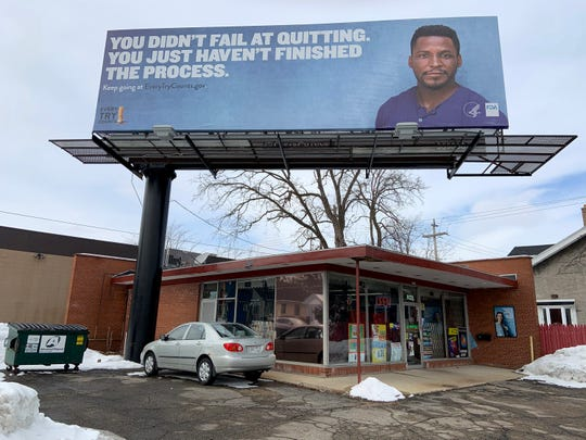 A quit-smoking billboard hangs directly above the Cigarette Depot, 2701 N. 76th St. Smokers walking into the store said the sign has no effect on their desire to smoke.