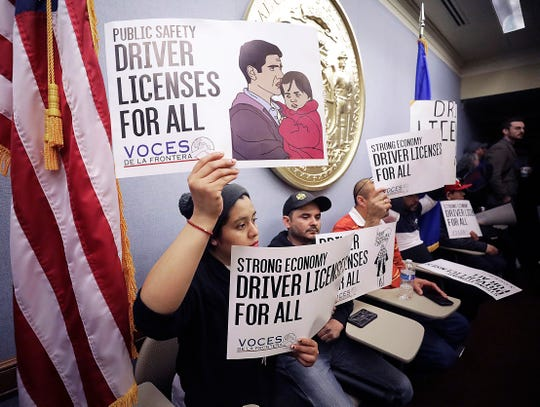 Supporters of a proposed state budget inclusion that would provide immigrants without Social Security numbers an opportunity to obtain a driver's license gather for a rally and press conference at the Wisconsin State Capitol in Madison, Wis. Thursday, March 14, 2019.