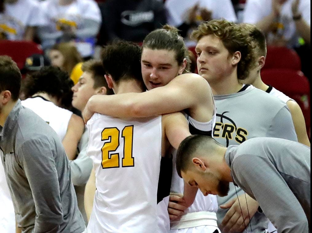 Northwestern's Jenner Graff is comforted by a teammate at the end of the game.