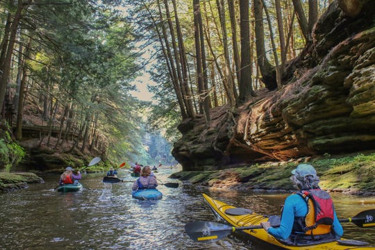 Kayakers paddle through the Dells of the Wisconsin River on a field trip with the Natural Resources Foundation of Wisconsin.