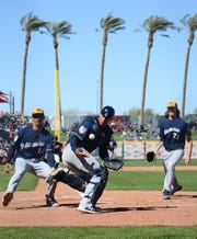 Brewers catcher Jacob Nottingham bobbles and catches a pop up during the fifth inning Wednesday.