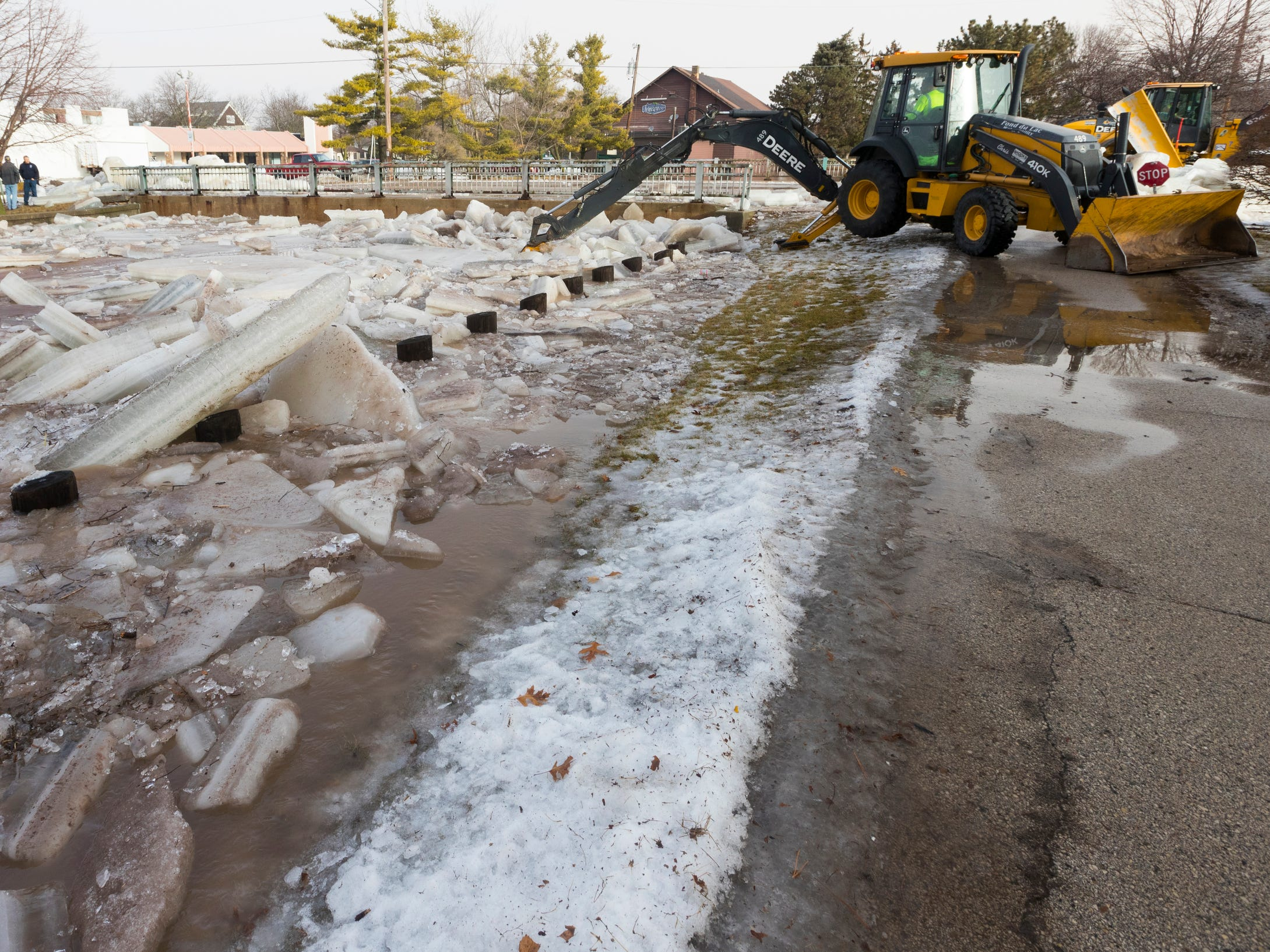 City of Fond du Lac public works crews clear an ice jam on the Fond du Lac River that caused flooding Thursday near downtown Fond du Lac.