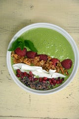 Matcha Green Smoothie Bowl can be topped with granola, fruit, seeds, cacao nibs and shaved coconut.