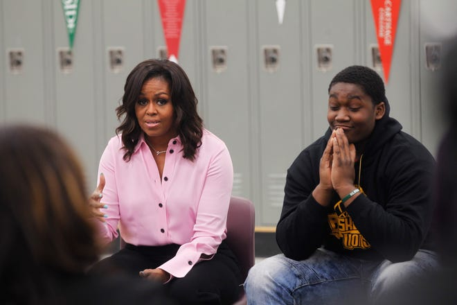 Danny Hunt, a junior at Milwaukee Collegiate Academy, listens as former first lady Michelle Obama talks about her own experiences applying to and getting accepted to Princeton University. Obama, who was in Milwaukee on March 14 to promote her book, made a surprise visit to the school to talk to juniors aspiring to go to college.