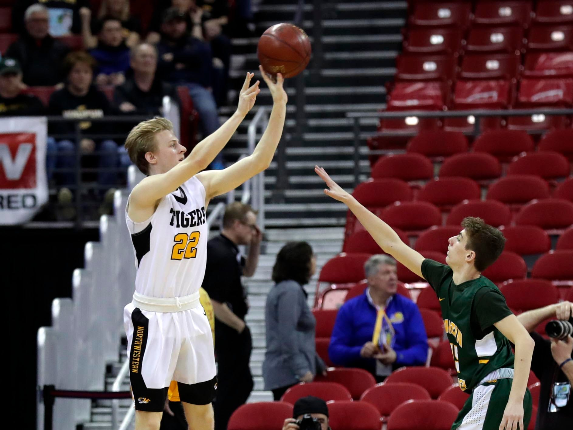 Northwewstern's Andrew Klobucher takes a three-point shot and finishes with 11 points.