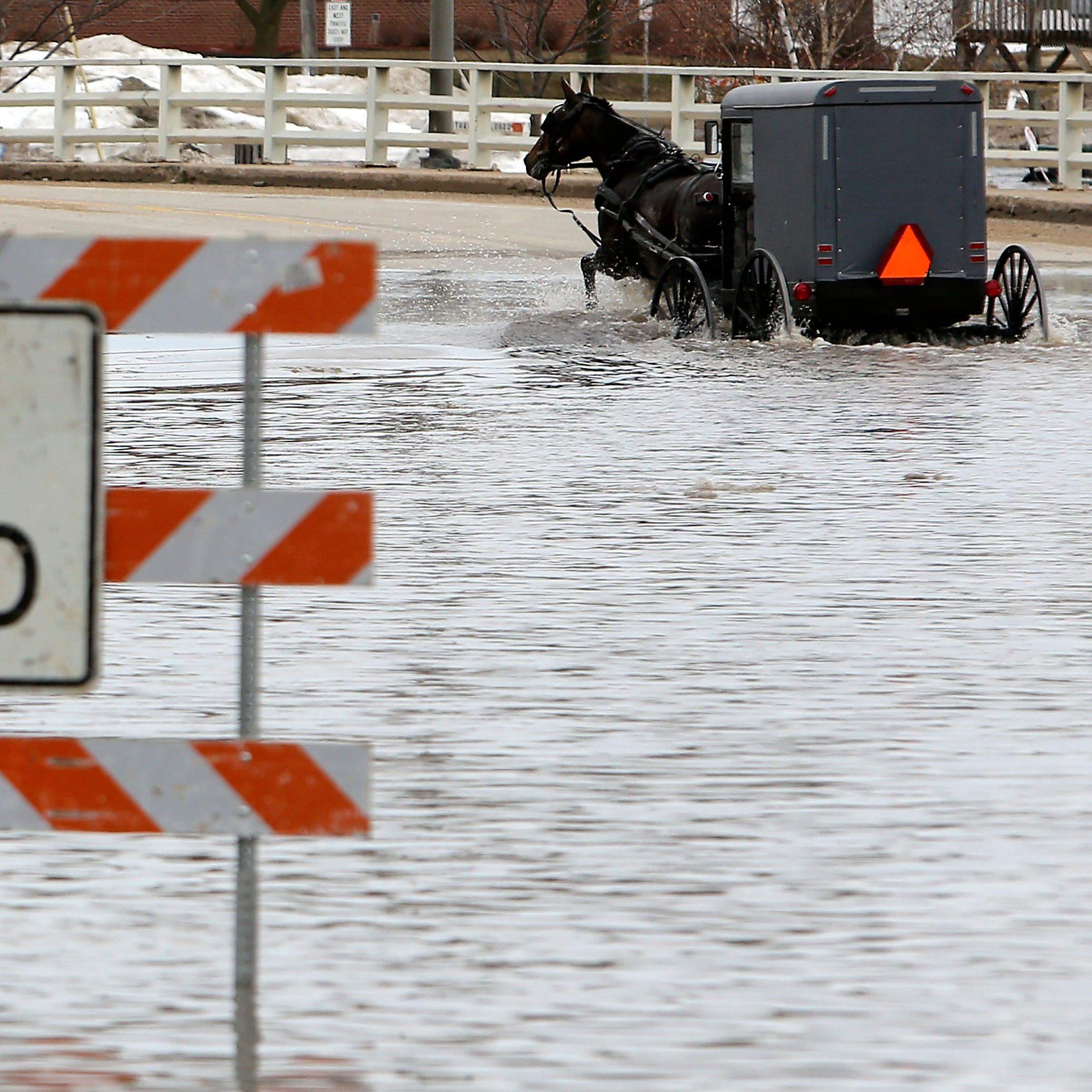 Wisconsin gets warm weather this week, and flooded rivers expected to crest soon and drop below flood stage