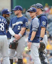 Brewers manager Craig Counsell makes a visit to the mound during a game last season. One of the MLB rule changes in effect this year limits mound visits from six to five.