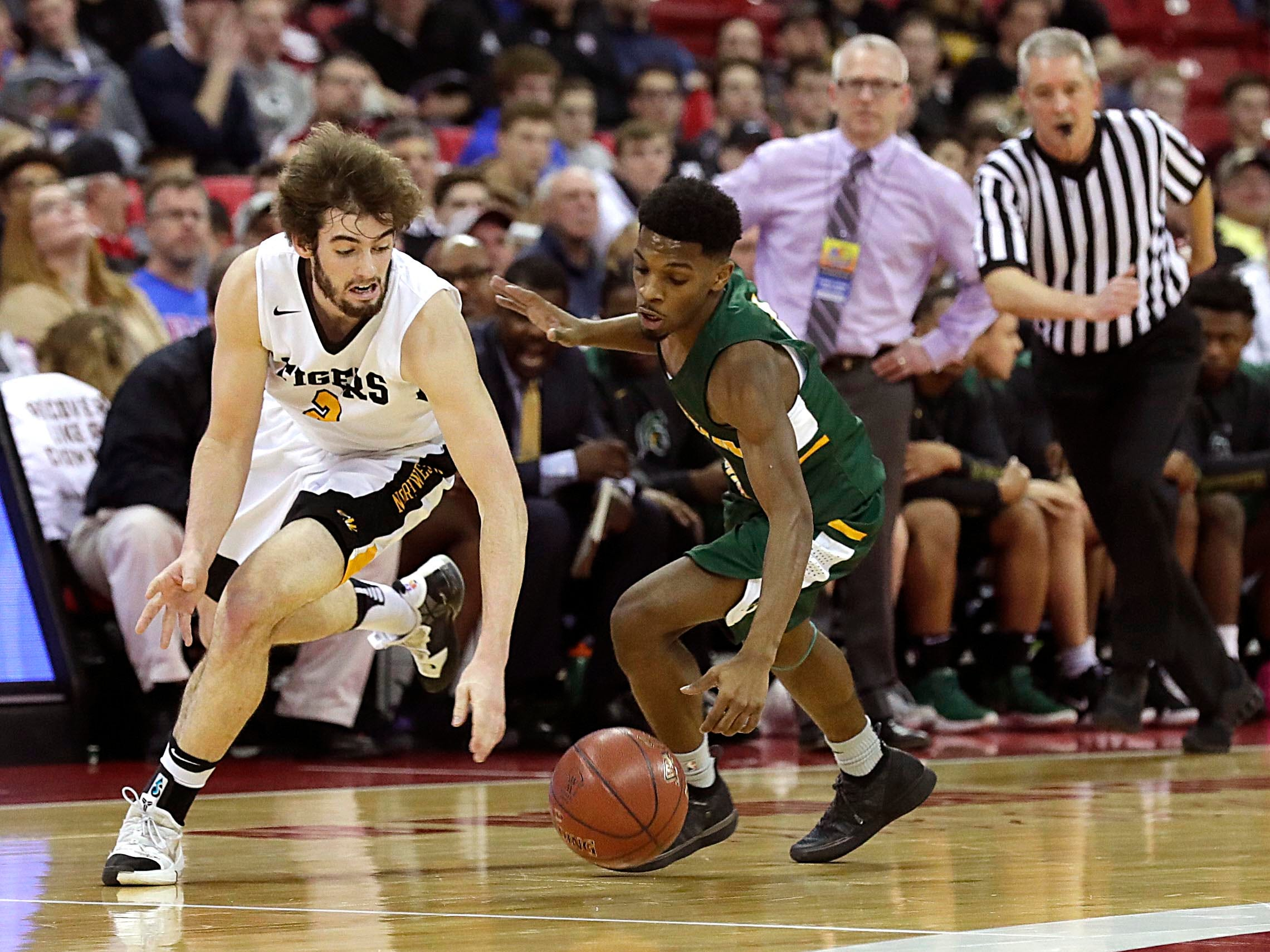 Northwestern's  Brody Payton  and Martin Luther's Trequan Carrington chase a loose ball on Thursday. Carrington scored 41 points, a WIAA division 3 state record.