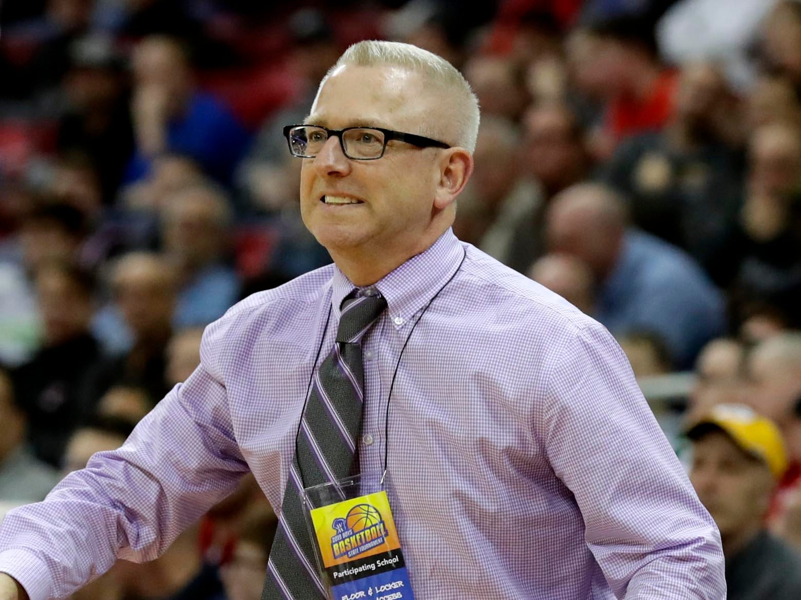 Martin Luthe coach Paul Wollersheim watches his team defeat Northwestern.