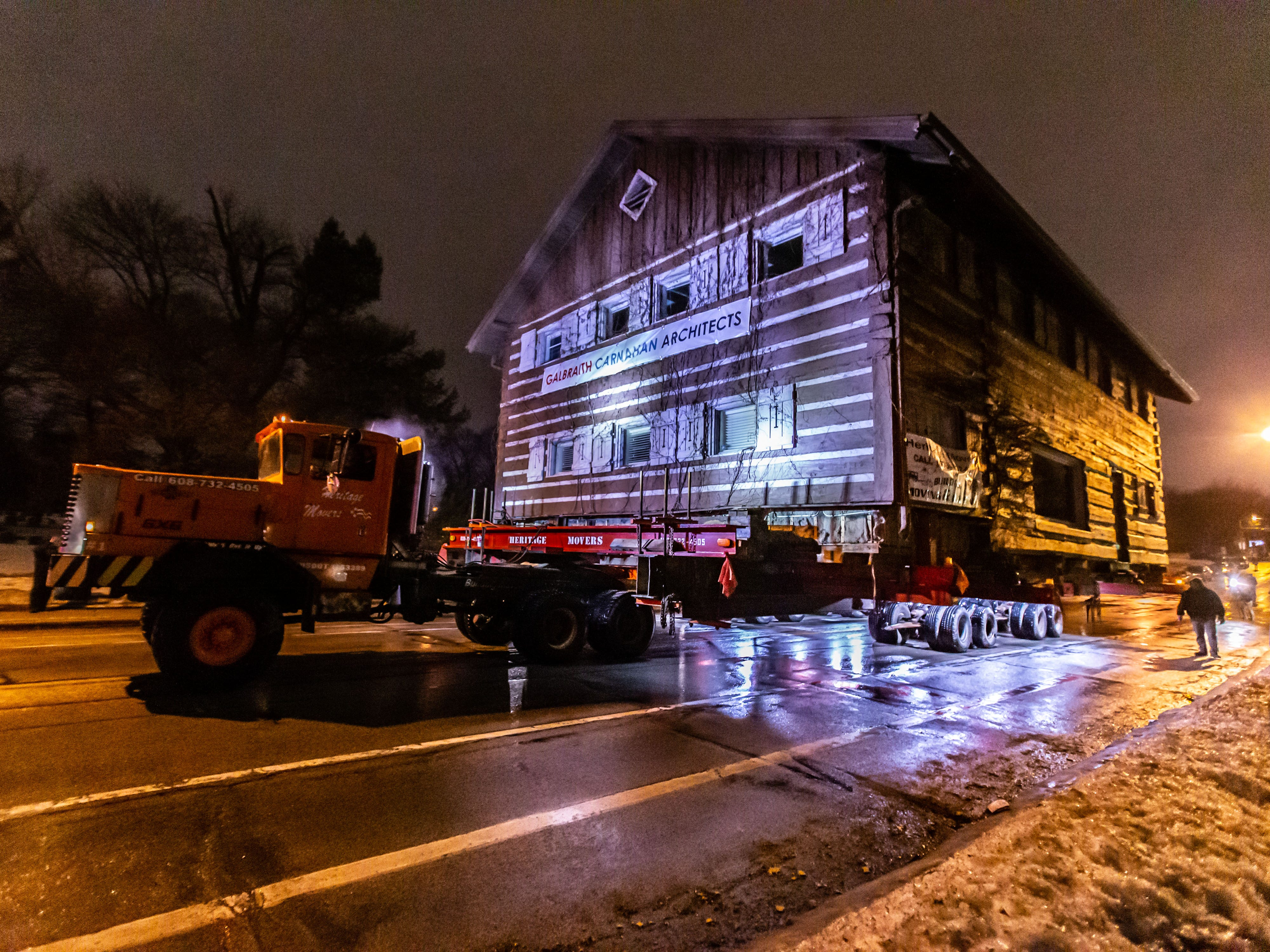 """The """"Tosa Log Cabin"""" rolls down N. Wauwatosa Ave. on it's journey to 6404 W. North Ave. on Wednesday evening, March 13, 2019. The cabin is being moved to make way for a three-story apartment complex called the Gallatin Apartments."""