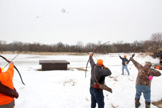 Archers attempt to hit a disc tossed in the air during a shoot-off at a traditional archery pheasant hunt in Pleasant Prairie, Wisconsin.