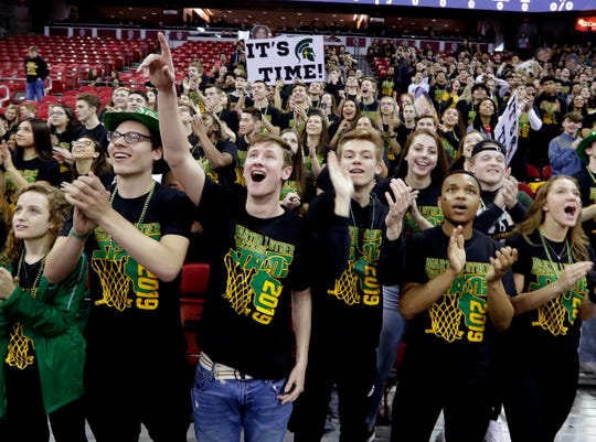 Martin Luther fans cheer during the Spartans'