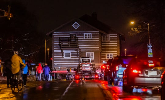"""The """"Tosa Log Cabin"""" rolls down North Wauwatosa Avenue on its journey to 6404 W. North Ave. on Wednesday night, March 13. The cabin was moved to make way for the three-story Gallatin Apartments."""