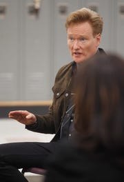 "Comedian and late-night talk-show host Conan O'Brien talks with Milwaukee high school students about their college aspirations during a round-table discussion Thursday at Milwaukee Collegiate Academy. O'Brien is in town to act as moderator of ""Becoming: An Intimate Conversation with Michelle Obama."" Hours before they were to take the stage, the two made a surprise visit at the school."