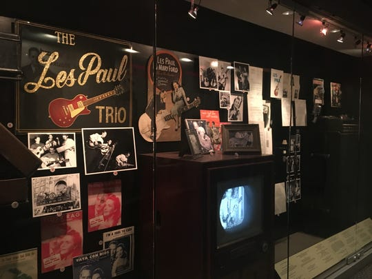 A display at the Rock and Roll Hall of Fame in Cleveland honors the work of Waukesha native Les Paul, creator of the solid-body electric guitar.