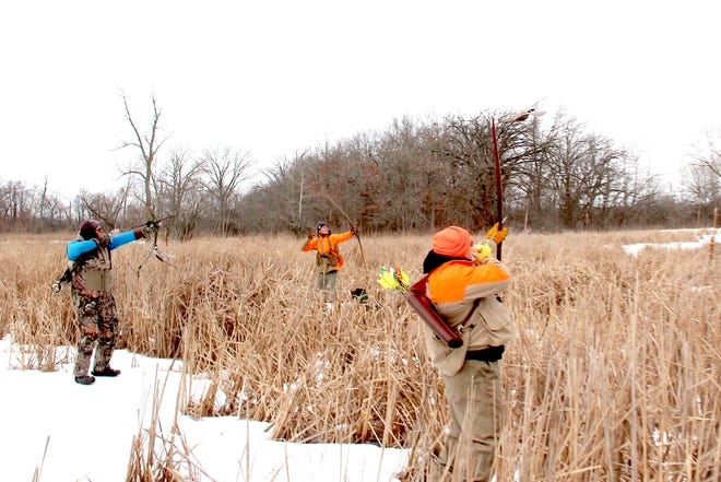 Archers, including (left to right) Scott Hodson of Portland, Oregon, Nick Ward of Libertyville, Illinois and Todd Barrowclift of St. Charles, Illinois, take aim at a flying ring-necked pheasant during a traditional archery hunt at a private property in Pleasant Prairie, Wisconsin.