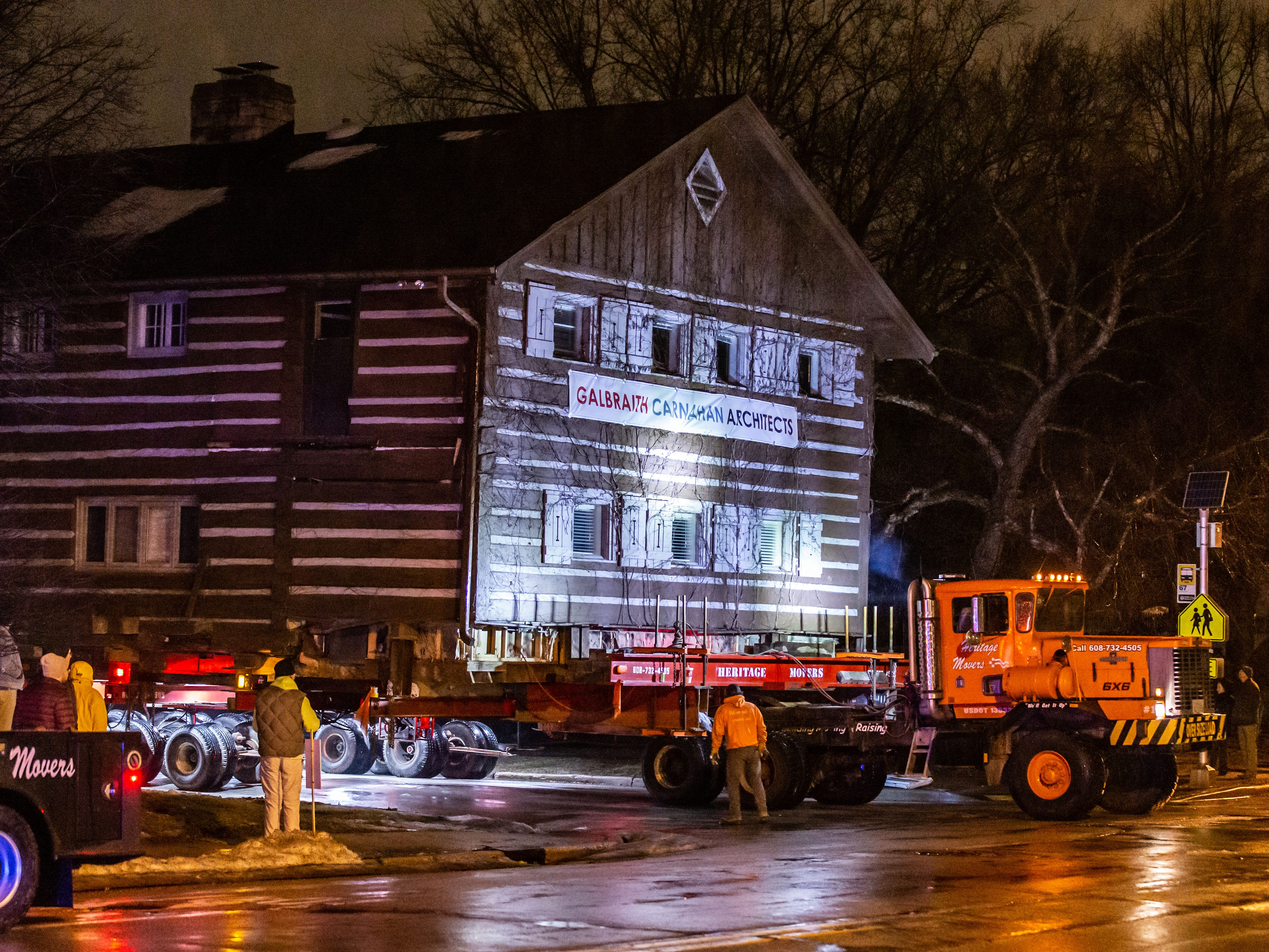 """The """"Tosa Log Cabin"""" turns onto N. Wauwatosa Ave. on it's journey to 6404 W. North Ave. on Wednesday evening, March 13, 2019. The cabin is being moved to make way for a three-story apartment complex called the Gallatin Apartments."""
