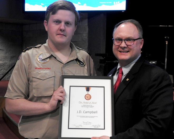 J.D. Campbell, an Eagle Scout from Mountain Home, receives the Medal of Merit from Chris Daughtrey, WestArk Council CEO. Campbell rescued a 4-year-old child who was choked by an improvised super-hero cape that became entangled in a bicycle sprocket.